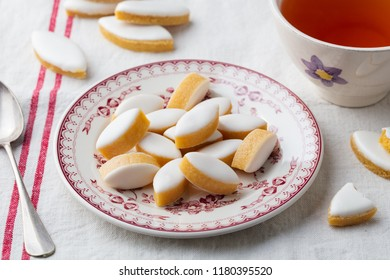 Calissons on a plate. Traditional French Provence sweets with cup of tea.