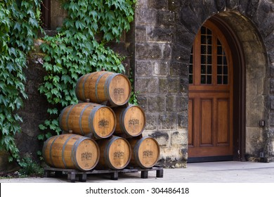 Calistoga, California - May 10 : Wine barrels stacked outside of the Chateau Montelena, May 10 2015 Calistoga, California.