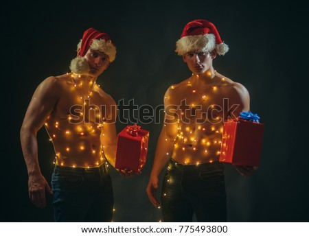call boys or sexy athlete men at xmas young men in santa costume present - Boys To Men Christmas
