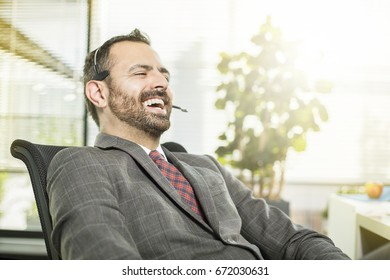 Call Center Agent with headset laughing