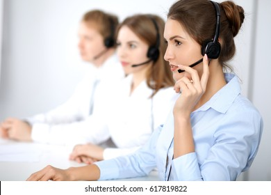Call center. Focus on beautiful business  woman in headset.