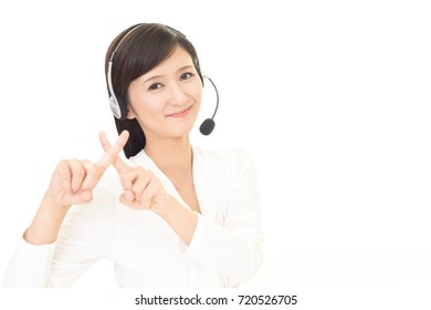Call center operator demonstrating prohibiting gesture