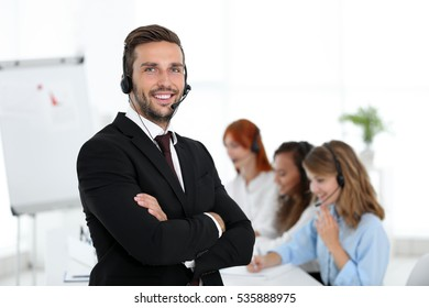 Call center operator with his colleagues