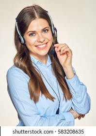 Call center operator isolated portrait with toothy smile. Blue office shirt