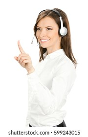 Call center. Portrait of happy smiling customer support service phone operator in headset pointing at something, isolated against white background.