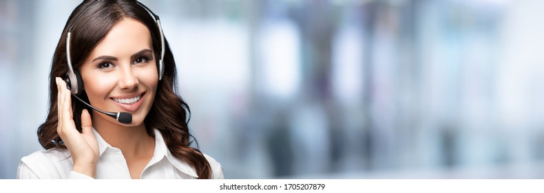 Call Center Service. Beautiful customer support or sales agent. Caller or receptionist phone operator. Copy space. Helping, answering, consulting. Over blurred office background.