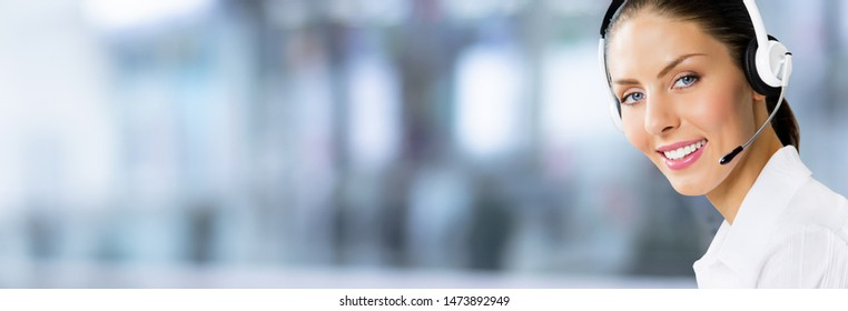Call Center Service. Face portrait of customer support or sales agent. Female caller or receptionist phone operator. Copy space for some text, advertising, slogan. Helpline answering and telemarketing