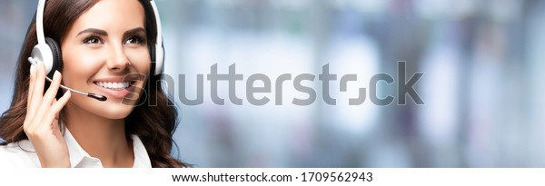 Call Center Service. Looking up customer support or sales agent. Caller or receptionist phone operator. Copy space. Helping, answering, consulting. Over blurred office background.