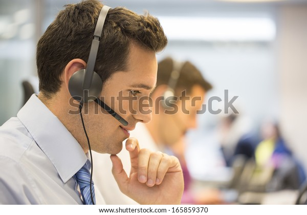 Call center team in the office on the phone with headset