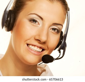 Call center woman with headset. Beautiful smiling caucasian woman isolated on white background.