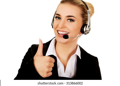 Call center woman with headset gesturing OK.