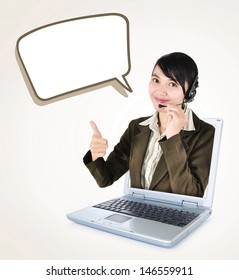 Call center woman with headset showing thumbs up with laptop, isolated on white background