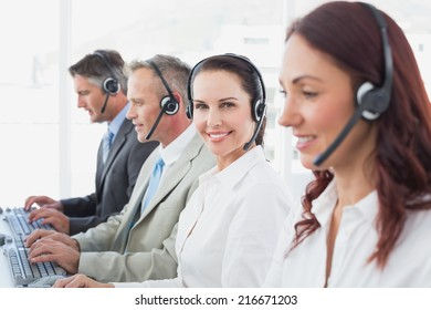 Call center workers all smiling at work