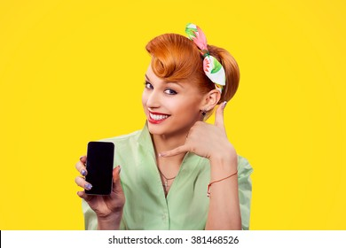Call me. Closeup red head young woman pretty smiling pinup girl green button shirt holding phone showing call me sign hands gesture looking at you camera, retro vintage 50's hairstyle. Body language