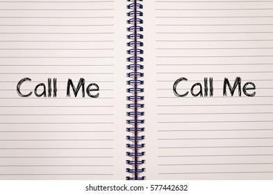 Call me text concept write on notebook