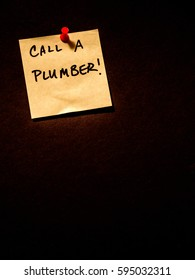 Call a plumber, post it note on black, portrait orientation