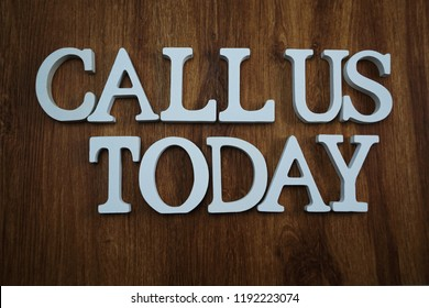 call us today alphabet letters top view on wooden background