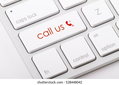 Call us word written on computer keyboard.