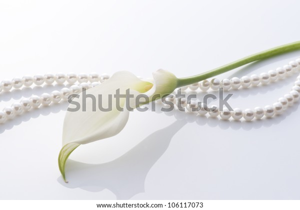 calla and pearl on white background