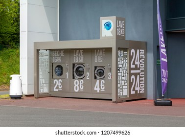Callac, Cotes-d'Armor, France - May 5 2016: Pay as you go washing machines outside of an Intermarche supermarket in Callac France