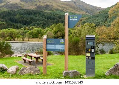 CALlANDER, SCOTLAND AUGUST 24, 2014: Parking signs at the Loch Lomond and Trossachs National Park site at Loch Lubnaig near Callander in Scotland.