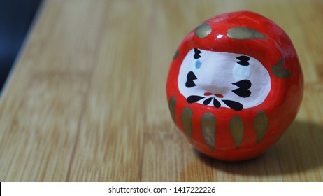 "It's called ""Daruma"" in Japanese, whitch means good luck. When you really want to do something successfully, you draw an eye on the ""Daruma"", and draw the other one when you done the work."