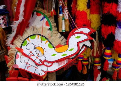 it called kuda lumping, a traditional Javanese toys. Kuda means a horse, because this toys is imitating a horse.
