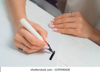 Calligrapher student practices in writing with black marker on canvas. Creative artist freelancer working on project at home studio. Lettering, handwriting concept.