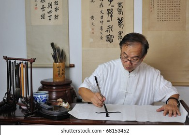 A calligrapher writing chinese calligraphy
