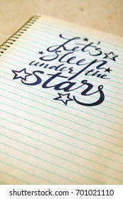 calligraphic background with romantic quote on spiral notebook