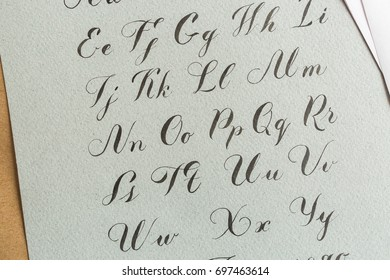 Writing cursive italic calligraphy writing upper case a f in