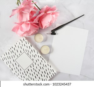 Calligraphy flatlay with notebook, calligraphy pen, flowers, candles and paper. Feminine mockup. Styled stock photography