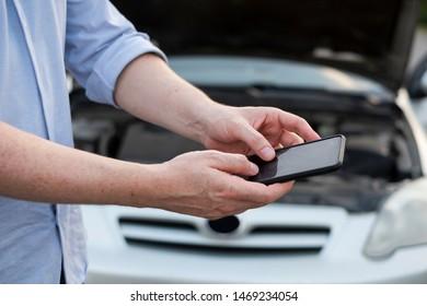 Calling roadside service after car engine breakdown