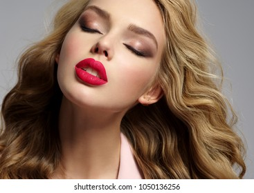 Calm beautiful young blond girl with sexy red lips. Portrait of a woman with closed eyes and quiet emotions