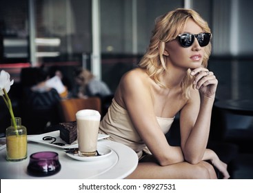 Calm blond beauty in a coffee shop