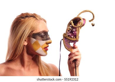 calm blonde woman with fashion makeup hold violet half mask, isolated on white