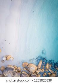 Calm blue waters with rocky coastline near Albany Western Australia.