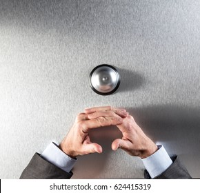 calm businessman crossing his hands next to a customer ring for patience and silence in management assistance, copy space, top view