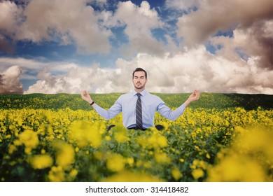 Calm businessman sitting in lotus pose against nature scene
