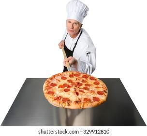 Calm Caucasian elderly man white in uniform holding food - Isolated