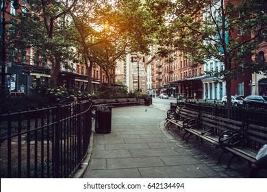 Calm city street park under sunlight in Manhattan, New York City