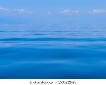 Calm clear blue water and waves background. Ohrid lake, Macedonia