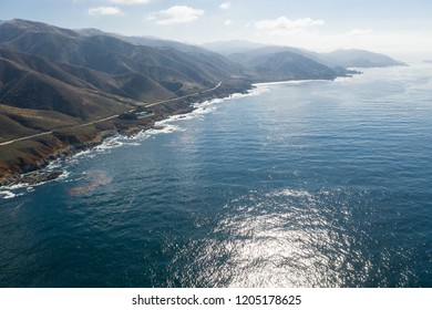 The calm, cold waters of the North Pacific Ocean wash against the rocky and scenic coastline of Northern California not far from Monterey.