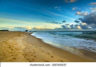 calm early morning gold coast beach surfers paradise city skyline footprints sandy surf waves headland Currumbin