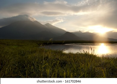 calm evening landscape with lake and mountains, Russia, Kamchatka