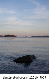 A calm evening in the Stockholm archipelago looking out over the tranquil water.
