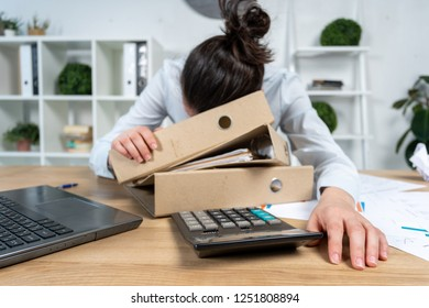 Calm exhausted dreamy brunette hair lady in her formalwear she snoozes lay table with charts graph graphics on loft interior workstation