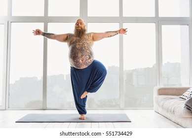 Calm fat man relaxing with meditation
