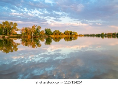 Calm fishing lake in northern Colorado sunset rteflection, summer scenery