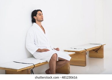 Calm guy relaxing at spa salon